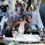 wedding party fishing boat frankfort michigan photo